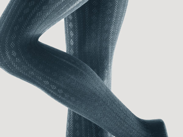 Ajour tights made of new wool with organic cotton