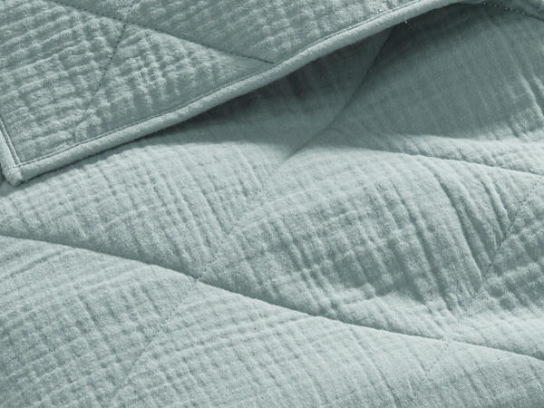 Muslin blanket made of organic cotton with wool filling