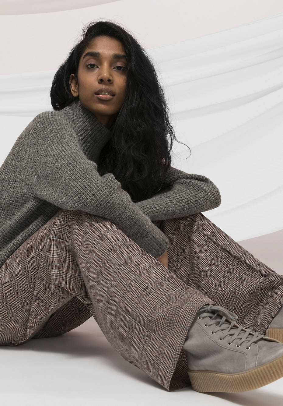 Flared checked trousers made from pure organic merino wool