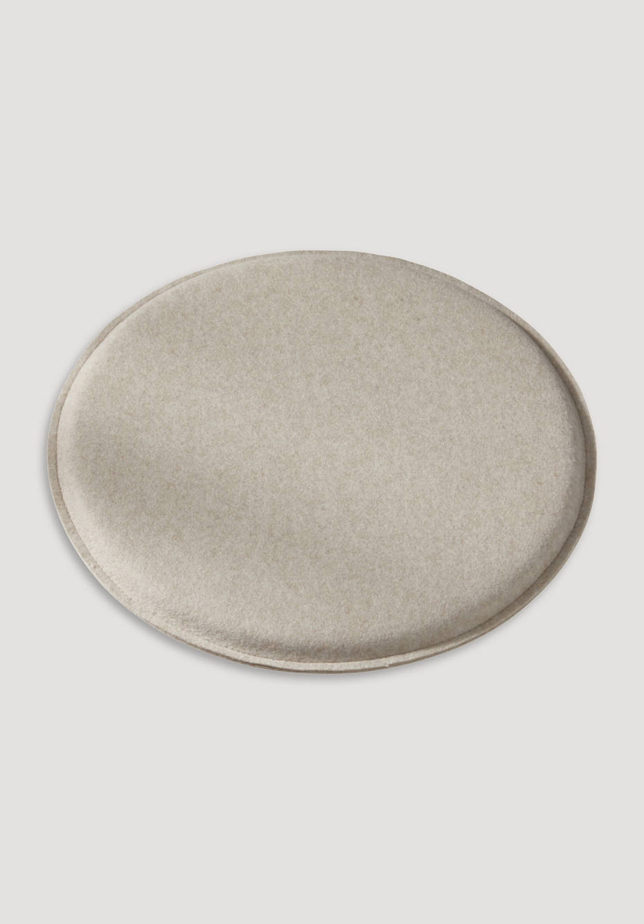 Round felt cushions made of virgin wool