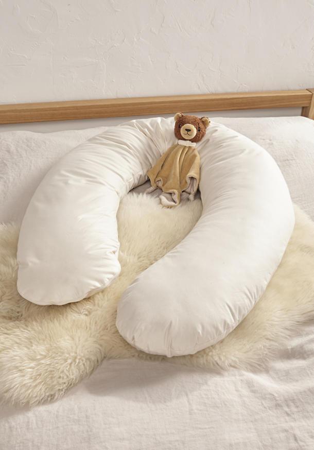 Nursing pillows and positioning pillows