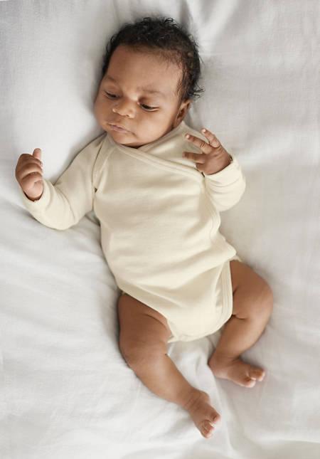 Long-sleeved wrap body made of organic merino wool with silk