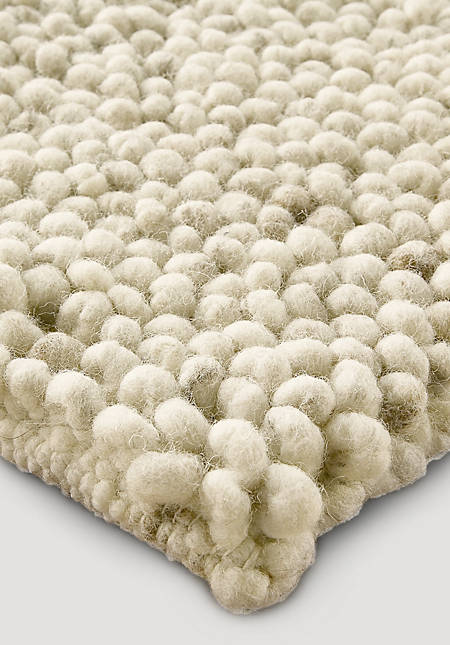 Looped carpet of dyke sheep made of pure new wool